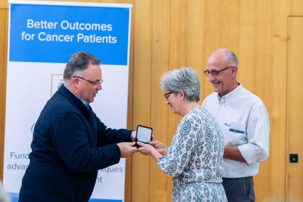 Helen receives her award from Adam